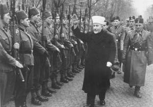Nakba instigator Husseini giving the Heil Hitler salute to Bosnian Muslim volunteers to the notorious Waffen SS (the Hanzar SS Division) in November, 1943 [Jerusalem Post Archives]