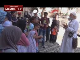 Arab Passerby Scolds Muslim preacher in Jerusalem for teaching young children to commit Murder – Suicide
