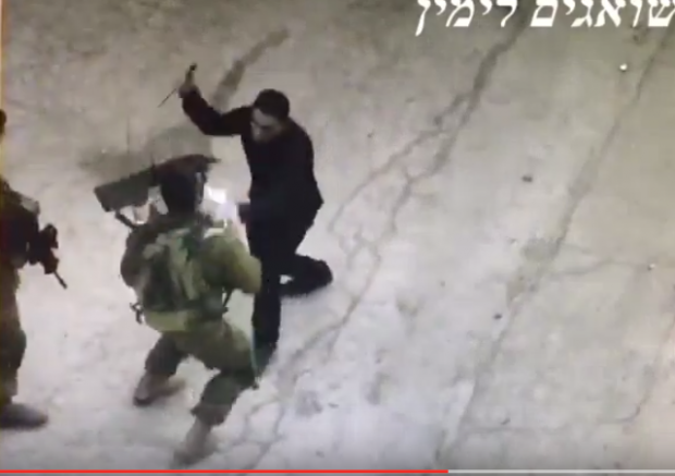 Video shows Arab offer papers, then attack soldier with