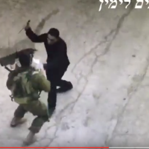 Video shows Arab offer papers, then attack soldier with knife