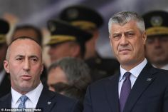 Kosovo president Hashim Thaci, right, and Kosovo prime minister Ramush Haradinaj participate in a Kosovo Security Force military and police force parade in capital Pristina on Sunday Feb. 18, 2018, marking the 10th anniversary of the country's independence. (AP Photo/Visar Kryeziu)