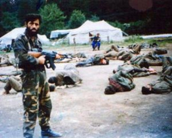 bosnia - muslim soldier with captives on ground