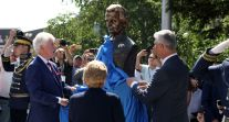 Clinton Albright Thaci - gaze on albright statue