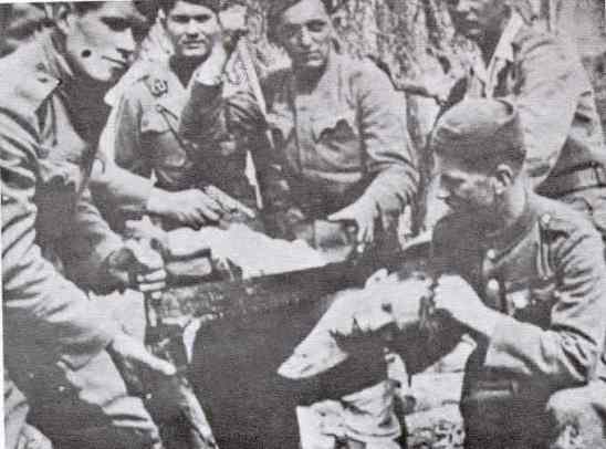 Croats beheading Serb with a saw WWII