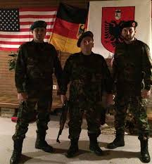 Albanian Lato - terrorists posing with flags and weapons