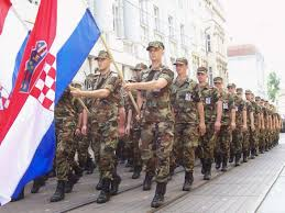 Croatia soldliers marching with ustasha flag