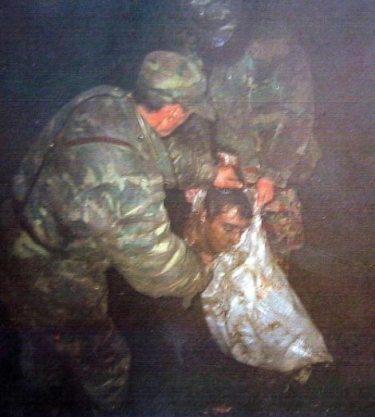 Kosovo - KLA - head in bag