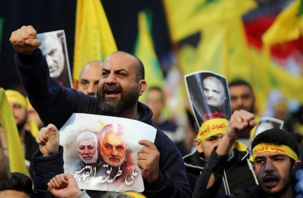 Lebanon's Hezbollah supporters chant slogans during a funeral ceremony rally to mourn Qassem Soleimani, head of the elite Quds Force, who was killed in an air strike at Baghdad airport, in Beirut's suburbs