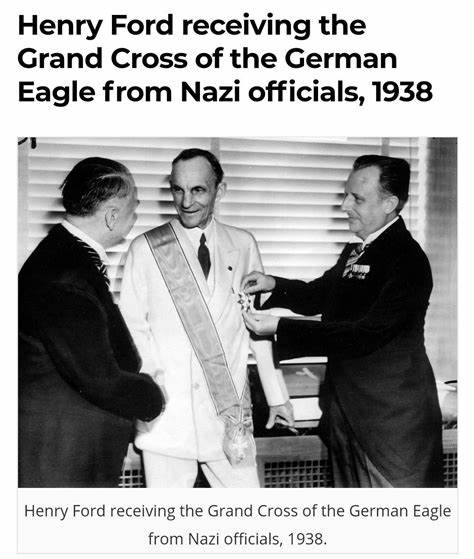 Ford Recieves Iron Cross from Nazi officials